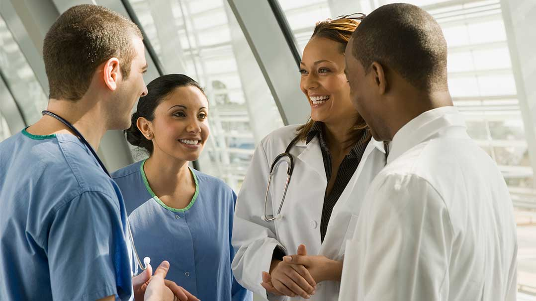 A group of multi-ethnic medical professionals talking.