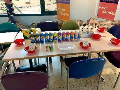 Craft table with paint and markers at the Helping Children Smile event