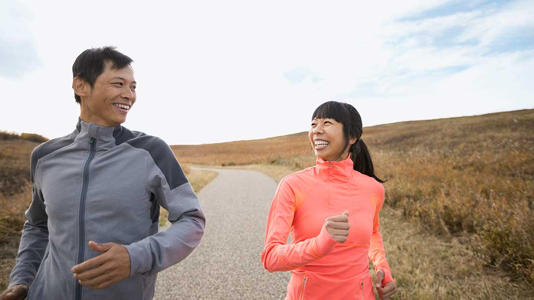 Couple happily jogging outside