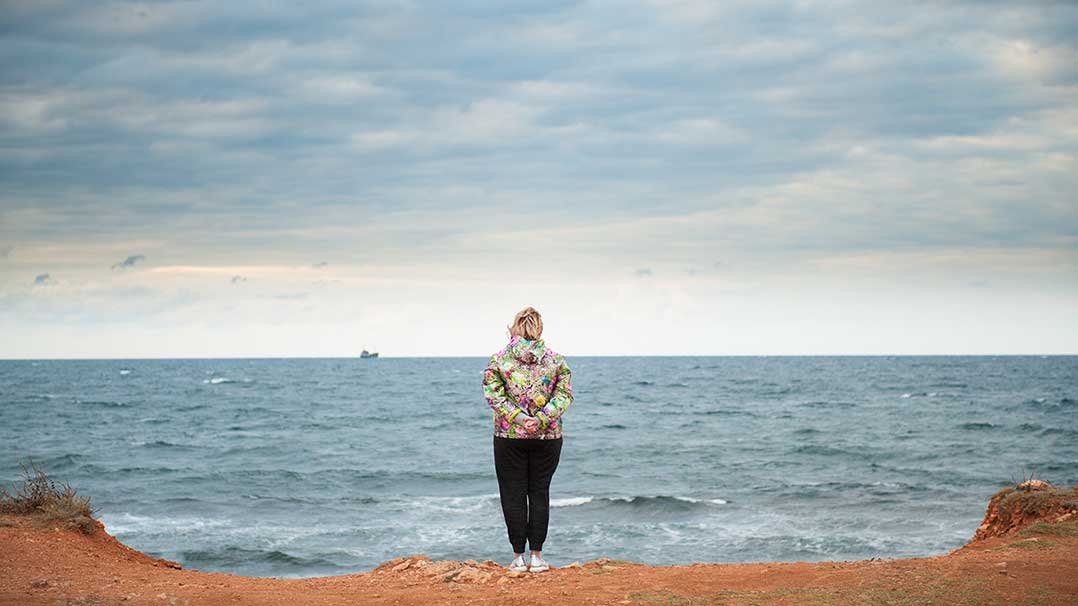 Woman staring off at the ocean