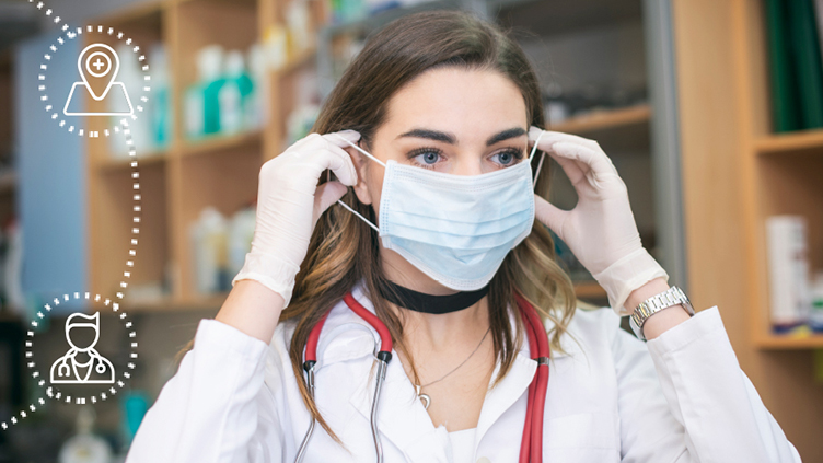 Female health care provider putting on a mask
